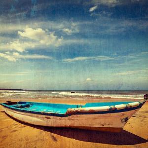 Vintage Retro Hipster Style Travel Image of Boat on a Beach, India  with Grunge Texture Overlaid by f9photos
