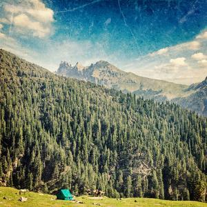 Vintage Retro Hipster Style Travel Image of Camp Tent in Himalayas Mountains with Overlaid Grunge T by f9photos