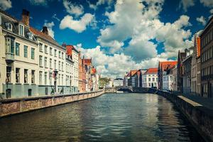 Vintage Retro Hipster Style Travel Image of Canal and Old Houses in Bruges (Brugge), Belgium by f9photos