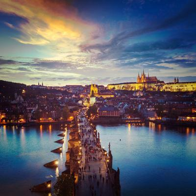 Vintage Retro Hipster Style Travel Image of Night Aerial View of Prague Castle and Charles Bridge O