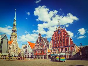 Vintage Retro Hipster Style Travel Image of  Riga Town Hall Square, House of the Blackheads and St. by f9photos