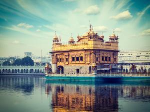 Vintage Retro Hipster Style Travel Image of Sikh Gurdwara Golden Temple (Harmandir Sahib). Amritsar by f9photos