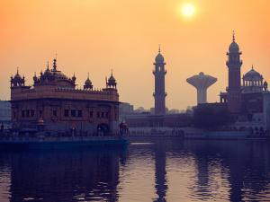 Vintage Retro Hipster Style Travel Image of Sikh Gurdwara Golden Temple (Harmandir Sahib) on Sunris by f9photos