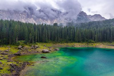 The Astonishing Colours of the Water of the Karersee, in Trentino, During a Rainy Day