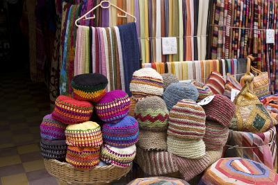 Fabrics, Tapestries, Cushions and Knitted Hats for Sale in the Souk, Essaouira, Morocco-Natalie Tepper-Photo