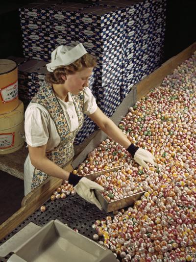 Factory Worker Sorts Through Candy on a Conveyor Belt-Willard Culver-Photographic Print