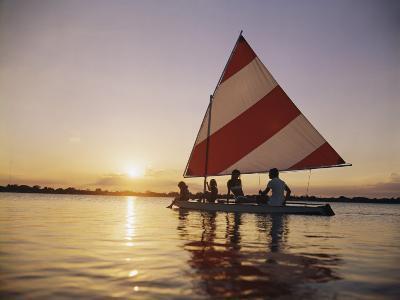 Family Sailing in Lake at Sunset-Dennis Hallinan-Photographic Print
