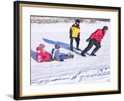 Family Tobogganing--Framed Photographic Print