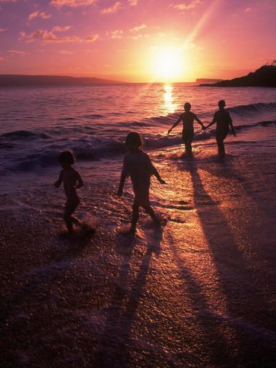 Family Walking on Beach at Dusk, HI-Mark Gibson-Photographic Print