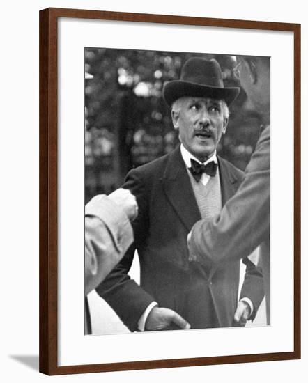 Famous Maestro Arturo Toscanini Stopping in Street and Talking to 2 Men-Alfred Eisenstaedt-Framed Premium Photographic Print