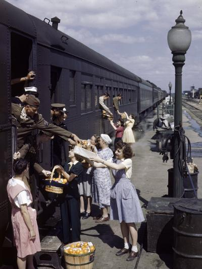 Farm Women Give Gifts of Food to Service Men Traveling by Train-B^ Anthony Stewart-Photographic Print