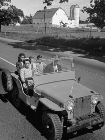 Farmer and Family Riding in a Jeep in Demonstration of Postwar Uses for Military Vehicles