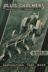 Farmer on an Allis Chalmers Tractor Plowing a Field