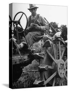 Farmer Sitting on Plow