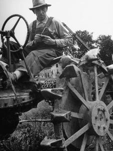 Farmer Sitting on Plow