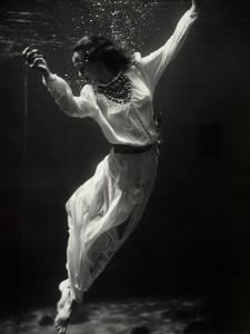 Fashion Model Underwater in Dolphin Tank