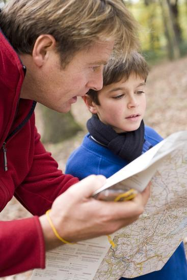 Father And Son Reading a Map-Ian Boddy-Photographic Print