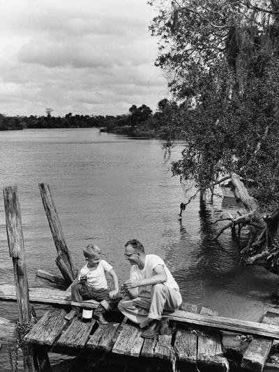 Father and Son Sitting on Dock Getting Ready To Fish--Photographic Print
