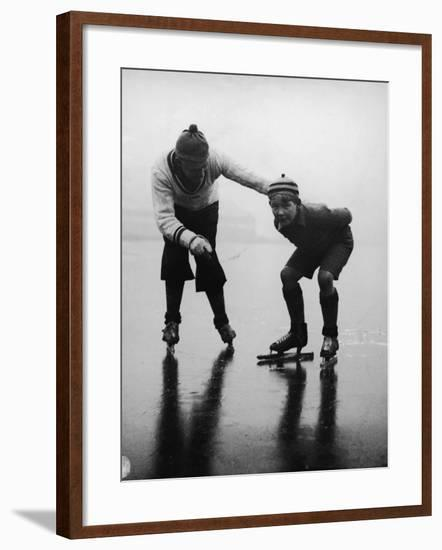 Father Teaching Son To Ice Skate on Frozen Lake--Framed Photographic Print