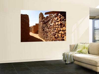Narrow Alleyway Through Ruins of Desert Town