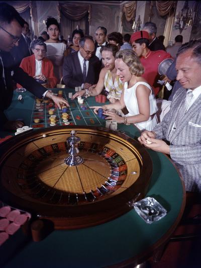 February 11, 1957: Tourists Gambling at the Nacional Hotel in Havana, Cuba-Ralph Morse-Photographic Print
