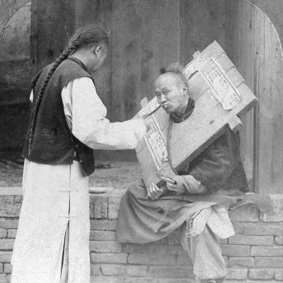 Feeding a Prisoner Wearing a Cangue, China, 1902-CH Graves-Photographic Print