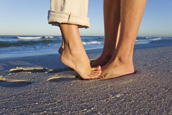 Feet of Couple Hugging on Beach-Martin Harvey-Photographic Print