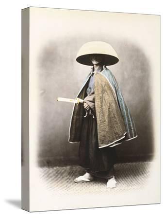 A Japanese Samurai in Traditional Costume, C.1868 (Hand Tinted Albumen Print)