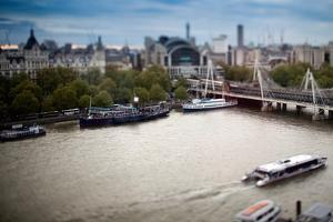 Aerial View of Ships and Boats on the Thames River with the Hungerford Bridge on the Background by Felipe Rodriguez