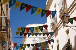 Building in Cadiz in Spain with Flags by Felipe Rodriguez