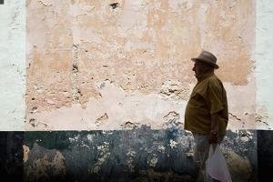 Elderly Man Walking in Street by Felipe Rodriguez