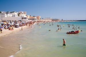 People on Beach in Spain by Felipe Rodriguez