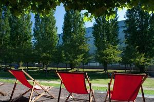 Red Deck Chairs on the Courtyard of the Jewish Museum, Berlin, Germany by Felipe Rodriguez