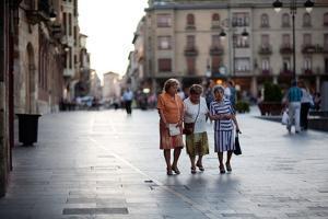 Three Ladies Walking in Spanish Street by Felipe Rodriguez