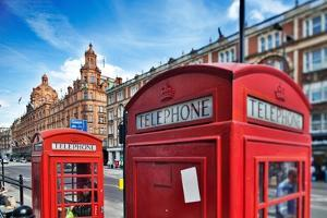 Typical Red Telephone Boxes on Brompton Road with Harrods Building on the Background by Felipe Rodriguez