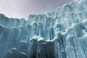 Translucent Blue Icicles in a Frozen Ice Wall by Felix Lipov