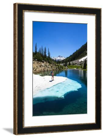 Female Backpacker Stands On A Floating Shelf Of Snow Melt On Small Lake Along E Lostine River Trail-Ben Herndon-Framed Photographic Print