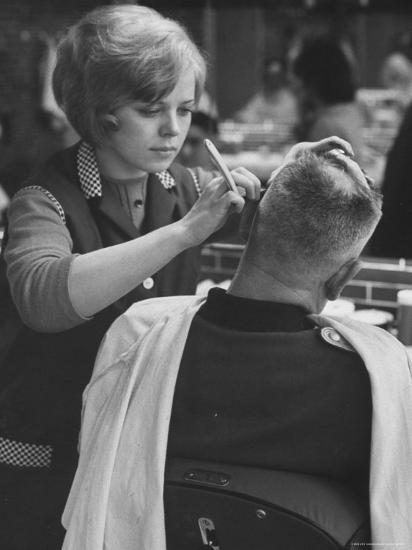 Female Barber Cutting a Customer's Hair in a Barber Shop-Ralph Crane-Photographic Print