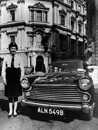 Female Chauffeur Standing by a 1964 Morris Oxford, 1964--Photographic Print