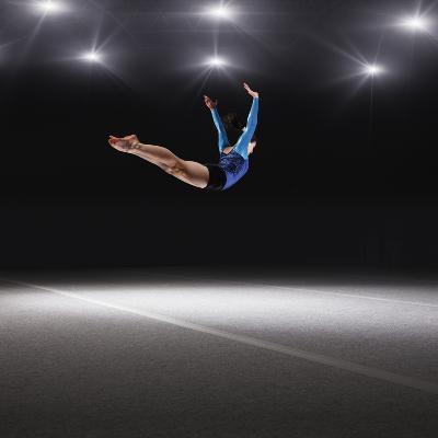 Female Gymnast Jumping through Air-Robert Decelis Ltd-Photographic Print