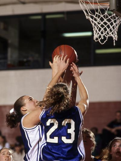 Female High School Basketball Players in Action During a Game--Photographic Print