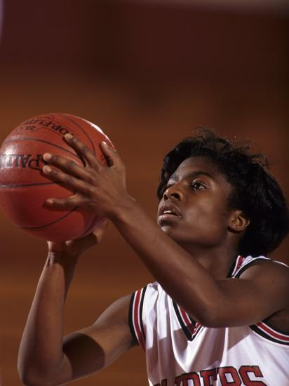 Female High Schooll Basketball Player in Action Shooting a Free Throw During a Game--Photographic Print