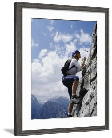 Female Mountain Climber Looking Up--Framed Photographic Print