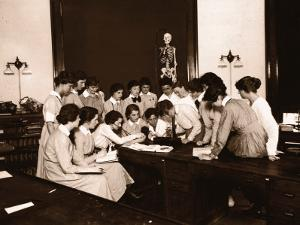Female Nursing Students Watching Blood Pressure Demonstration
