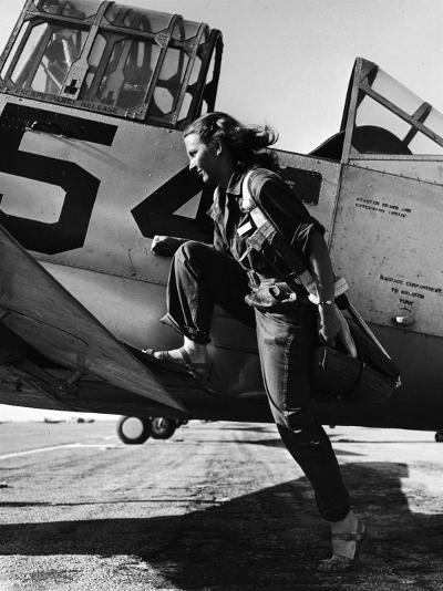 Female Pilot of the Us Women's Air Force Service Posed with Her Leg Up on the Wing of an Airplane-Peter Stackpole-Photographic Print