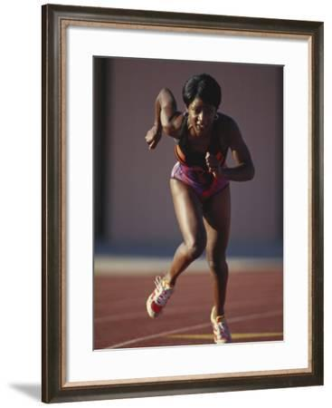 Female Runner at the Start of a Track Race--Framed Photographic Print
