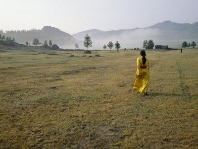 https://imgc.artprintimages.com/img/print/female-shaman-walks-across-grass-in-a-bright-yellow-silk-robe_u-l-p9c2zp0.jpg?p=0