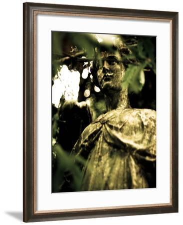 Female Statue Partly Obscured by Leaves in Cemetery-Clive Nolan-Framed Photographic Print