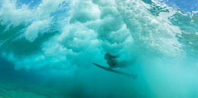 Female Surfer Pushes under a Wave While Surfing, Clansthal, South Africa