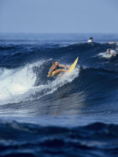 Female Surfer Riding a Wave--Photographic Print